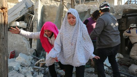 Syrian girls react following a reported Syrian regime air strike in a rebel-controlled area in the northern city of Aleppo on February 8, 2016.  Regime forces backed by intense Russian air strikes have closed in on Aleppo city in their most significant advance since Moscow intervened in September in support of President Bashar al-Assad's government.   / AFP / Ameer al-Halbi        (Photo credit should read AMEER AL-HALBI/AFP/Getty Images)