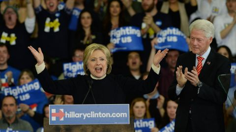 HOOKSETT, NH - FEBRUARY 9:  Democratic presidential candidate Hillary Clinton speaks as husband, former President Bill Clinton looks on at Southern New Hampshire University February 9, 2016 in Hooksett, New Hampshire. (Photo by Darren McCollester/Getty Images)