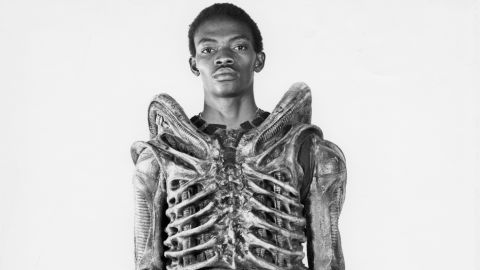 """Bolaji Badejo became one of cinema's most feared villains almost by accident. After a lengthy casting process, agent Peter Ardram came across Badejo in a pub in London. Thinking that the 6'10"""" Nigerian matched the thin, insect-like profile director Ridley Scott required, he arranged for the two to meet. (Image: courtesy<a href=""""http://www.mikesibthorp.com/"""" target=""""_blank"""" target=""""_blank""""> Mike Sidthorp</a>.)"""