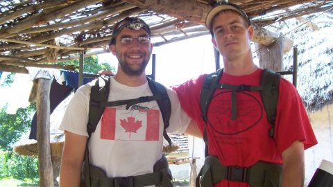 Graduate student Kevin Kobylinski, left, and microbiologist  Brian Foy in Senegal.