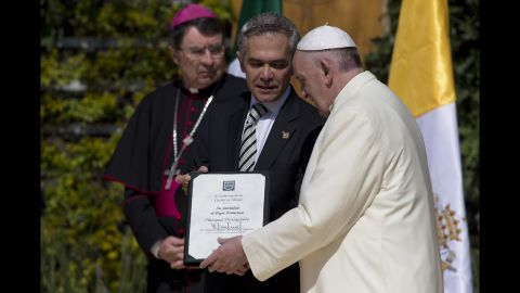 Pope Francis is recognized as a distinguished guest by Mexico City Mayor Miguel Angel Mancera on February 13.