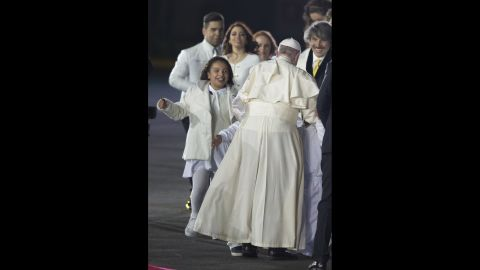 A group of children runs to embrace the Pope during his welcoming ceremony in Mexico City on February 12.