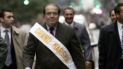 Surrounded by security, Scalia walks in the annual Columbus Day Parade on October 10, 2005, in New York City.