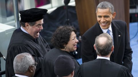 U.S. President Barack Obama greets Supreme Court Justices Clarence Thomas, Antonin Scalia, Sonia Sotomayor, Anthony Kennedy and John Roberts at Obama's inauguration for his second term of office.