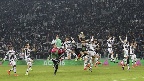 Juventus players celebrate its narrow 1-0 win over Napoli on February 13.