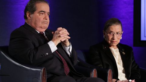 """Supreme Court Justices Antonin Scalia (L) and Ruth Bader Ginsburg (R) wait for the beginning of the taping of """"The Kalb Report"""" April 17, 2014 at the National Press Club in Washington, DC."""