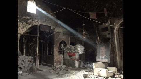 SYRIA: A portrait of Syrian President Bashar al-Assad lies in a burnt our building used by government forces in the Old Town of Aleppo. Photo by CNN's Fred Pleitgen @fpleitgencnn.