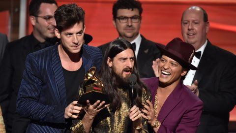 """""""Uptown Funk,"""" Mark Ronson featuring Bruno Mars. Holding the Grammy between the two is producer Jeff Bhasker. The song also won the Grammy for best pop duo/group performance."""