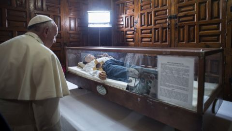 Pope Francis pays his respects to Jose Sanchez del Rio at a cathedral in Morelia, Mexico, on Tuesday, February 16. Jose, 14, was killed by government officials in 1928 after he refused to renounce his Catholic faith.