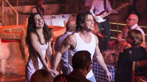 """While they chow on Mediterranean food, the audience watches a show loosely based on the successful """"Mamma Mia!"""" musical and movie that intertwined a love story with the songs of ABBA."""