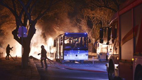 Firefighters work at a scene of fire from an explosion in Ankara, Wednesday, Feb. 17, 2016. A large explosion, believed to have been caused by a bomb, injured several people in the Turkish capital on Wednesday, according to media reports. Private NTV said the explosion occurred during rush hour in an area close to where military headquarters are located as a bus carrying military personnel was passing by. Several cars caught fire, the report said. Ambulances were seen rushing toward the scene. The explosion caused a large fire and dark smoke could be seen billowing from a distance. (IHA via AP) TURKEY OUT