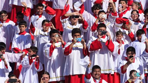 Altar boys cheer as the Pope arrives in Ciudad Juarez on February 17.
