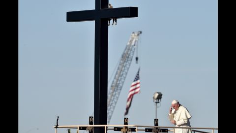 Pope Francis prays next to he US border before celebrating mass at the Ciudad Juarez fairgrounds on February 17, 2016. Throngs gathered at Mexico's border with the United States on Wednesday for a huge mass with Pope Francis highlighting the plight of migrants -- a hot-button issue on the US presidential campaign trail..   AFP PHOTO / GABRIEL BOUYS / AFP / GABRIEL BOUYS        (Photo credit should read GABRIEL BOUYS/AFP/Getty Images)