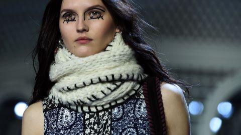 A model displays an ensemble by Altuzarra, a luxury women's ready-to-wear brand launched in New York by designer Joseph Altuzarra in 2008.