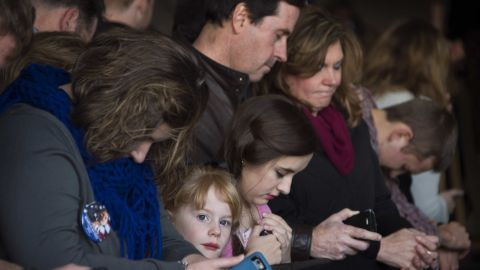A young girl looks out as supporters pray during the beginning of a Republican presidential candidate Marco Rubio rally in Greenville, South Carolina, February 12, 2016.  / AFP / JIM WATSON        (Photo credit should read JIM WATSON/AFP/Getty Images)