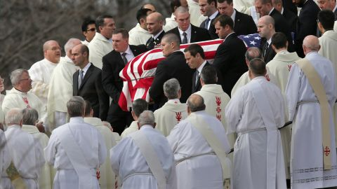 WASHINGTON, DC - FEBRUARY 20:  U.S. Supreme Court Police pallbearers carry Associate Justice Antonin Scalia's flag-covered casket between rows of Catholic clergy and out of the Basilica of the National Shrine of the Immaculate Conception following his funeral February 20, 2016 in Washington, DC. Scalia, who died February 13 while on a hunting trip in Texas, layed in repose in the Great Hall of the Supreme Court on Friday and his funeral service will be at the basillica today.  (Photo by Chip Somodevilla/Getty Images