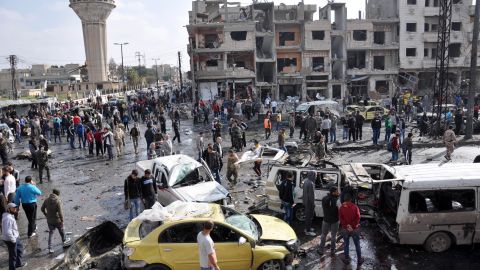 """Syrians gather at the site of a double car bomb attack in the Al-Zahraa neighborhood of the Homs, Syria, on February 21, 2016. <a href=""""http://www.cnn.com/2016/02/21/middleeast/syria-civil-war/index.html"""" target=""""_blank"""">Multiple attacks in Homs and southern Damascus</a> kill at least 122 and injure scores, according to the state-run SANA news agency. ISIS claimed responsibility."""
