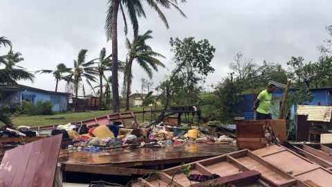 A man looks through the remains of a home in the town of Ba, Fiji, on February 21, after it was leveled by Tropical Cyclone Winston.