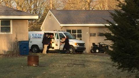 The Kalamazoo County sheriff removes items from Jason Brian Dalton's home.