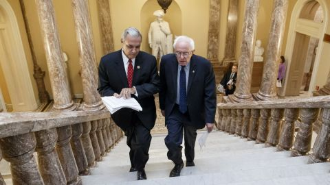 Sanders and US Rep. Jeff Miller, chairman of the House Committee on Veterans' Affairs, walk to a news conference on Capitol Hill in 2014. Sanders was chairman of the Senate Committee on Veterans' Affairs.
