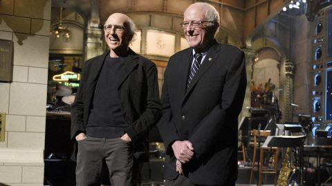 """Comedian Larry David and Sanders <a href=""""http://money.cnn.com/2016/02/07/media/bernie-sanders-larry-david-saturday-night-lvie/"""" target=""""_blank"""">appear together on """"Saturday Night Live""""</a> in February 2016. David had played Sanders in a series of sketches throughout the campaign season."""