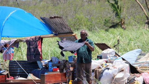 A Ba resident dries his belongings, in an image released by the Fiji government, February 22.