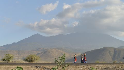 """Maasai women carry water near the border of Kenya and Tanzania. """"Women spend an average of four-and-a-half hours doing unpaid work every day, compared to an average of about two hours per day for men,"""" say Bill and Melinda Gates."""