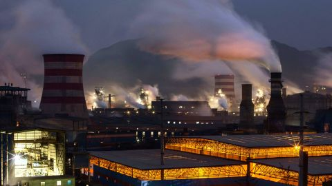"""Smoke billows in the industrial province of Hebei, China. """"We're betting that within 15 years, scientists and engineers will develop big breakthroughs that will put us on a path to zero carbon emissions,"""" the Gateses say."""