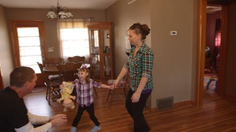 Anika Aramburu plays with her mother, Angelina, and her father, Jesse Carter.
