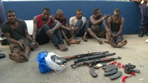 The suspected hijackers, all Nigerians, are paraded in front of the media in Lagos.