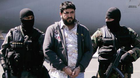 Mexican police escort Alfredo Beltran Leyva after his arrest in 2008.