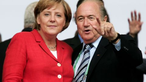 BERLIN - JUNE 30:  German Chancellor Angela Merkel chats to FIFA President Sepp Blatter prior to the FIFA World Cup Germany 2006 Quarter-final match between Germany   and Argentina played at the Olympic Stadium on June 30, 2006 in Berlin, Germany.  (Photo by Martin Rose/Bongarts/Getty Images)