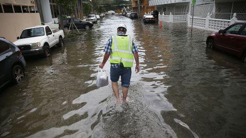 Howard Rogers walks through a flooded street in Miami Beach in September 2015.