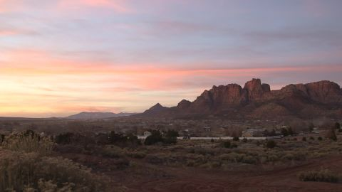 Hildale, Utah, and Colorado City, Arizona, nestle against red cliffs and together are known as Short Creek.