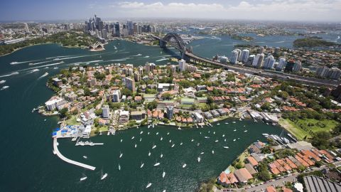 """The median price of a house in Sydney is <a href=""""https://www.domain.com.au/product/domain-house-price-report-december-2017/"""" target=""""_blank"""" target=""""_blank"""">$914,000</a>, while the national median price is $630,000, as of December 2017. Prices are highest around the harbor, encouraging residents to move further out of the city."""