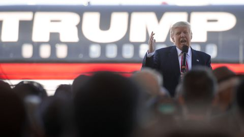 Republican Presidential candidate Donald Trump bashes Republican rival Marco Rubio as he talks to supporters at a campaign rally in an airplane hanger at Northwest Arkansas Regional Airport on February 27, 2016 in Bentonville, Arkansas.