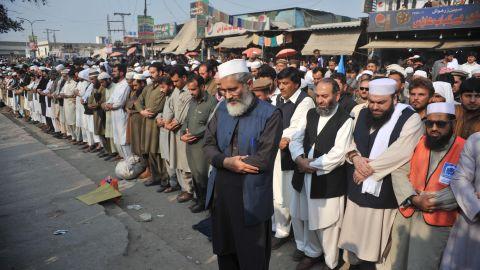 Pakistani political and Islamic party Jammat-e-Islami (JI) chief Siraj-ul-Haq (front) offers funeral prayers for  Qadri following his execution on February 29, 2016.