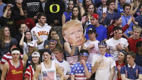 """Fans of Andrean High School held up a picture of GOP presidential candidate Donald Trump and shouted chants like """"Build a Wall"""" during a basketball game against Bishop Noll Institute on Friday in Merrillville, Indiana."""