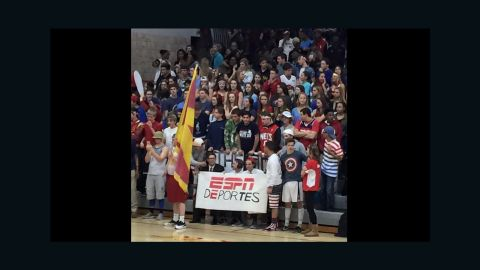 """Fans of Andrean High School held up a sign that reads """"ESPN deportes"""" and a poster of Donald Trump at a game in Merrillville, Indiana on Friday."""