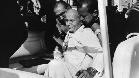 """<strong>Assassin targets Pope:</strong> Pope John Paul II collapses into the arms of his aides on May 13, 1981, after an <a href=""""http://www.nytimes.com/learning/general/onthisday/big/0513.html#article"""" target=""""_blank"""" target=""""_blank"""">assassination attempt</a> by Turkish terrorist Mehmet Ali Agca in St. Peter's Square. Struck by two bullets that hit his abdomen, right arm and left hand, the Pope was seriously wounded and underwent more than five hours of surgery to save his life. Agca went on to <a href=""""http://www.theguardian.com/world/2010/jan/18/pope-john-paul-mehmet-agca"""" target=""""_blank"""" target=""""_blank"""">serve 19 years</a> in an Italian prison. The Pope pardoned Agca in 1983 and worked for his eventual release."""
