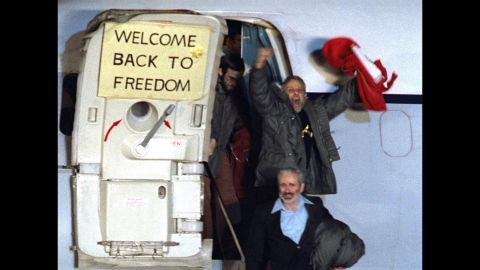 """<strong>U.S. hostages are released:</strong> David Roeder -- pictured here waving -- was one of 52 Americans held hostage for 444 days at the U.S. Embassy in Tehran, Iran. The<a href=""""http://www.cnn.com/2013/09/15/world/meast/iran-hostage-crisis-fast-facts/"""" target=""""_blank""""> Iran hostage crisis</a> began in November 1979, when Iranian students stormed the embassy to demand the extradition of Shah Mohammed Reza Pahlavi from the United States. It ended with the release of captives on January 20, 1981."""