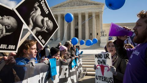 Anti-abortion, left, and abortion rights advocates face off this month outside the U.S. Supreme Court.