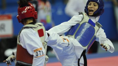Judoka Raheleh Asemani (right) is among the athletes bidding to compete for the team of refugees in Rio