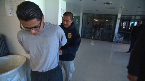 Security is vigilant at Barry Nidorf Juvenile Hall in Sylmar, California, where Carlos Adrian Vazquez Jr. is being handcuffed.