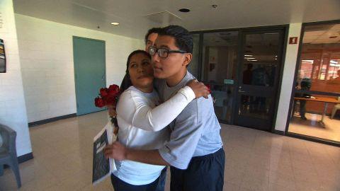 Carlos Adrian Vazquez Jr. hugs his mother, Adriana Garcia, in juvenile jail.