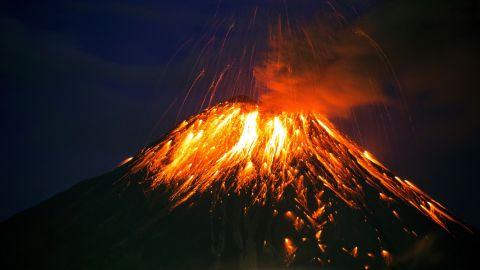 The Ecuadorian volcano Tungurahua spews lava and ash in Cahuaji, about 80 miles south of Quito, in February 2016. Authorities raised the alert level from yellow to orange after the volcano increased its activity and projected a column of ash 3 miles high.