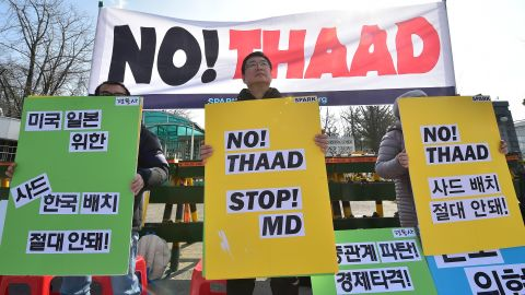 Anti-war activists hold placards during a rally against THAAD in 2016.