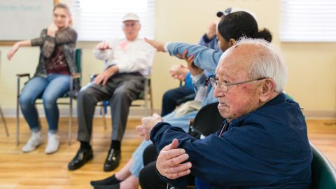 Toru Lura, stretches during the morning exercises at the WISE & Healthy Aging adult day service center for seniors with dementia in Santa Monica, California, in February 2016.