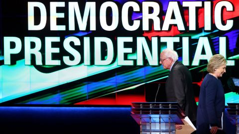 Democratic presidential candidate Senator Bernie Sanders (D-VT) and Democratic presidential candidate Hillary Clinton walk off stage during a break in the CNN Democratic Presidential Primary Debate at the Whiting Auditorium at the Cultural Center Campus on March 6, 2016 in Flint, Michigan.