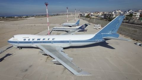 Old planes sit in an abandoned airport that is being used to house migrants in Athens, Greece. 5th March 2016